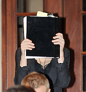 20.JULY.2010. LONDON<br /> <br /> MADONNA LEAVING THE GRAND HOTEL, TRAFALGAR SQUARE COVERING HER FACE WITH A NOTEBOOK AT 12.00AM AND WITHIN A 100 YARDS OF WERE SHE WAS THEIR WAS A BOMB SCARE AS A SUSPECT PACKAGE WAS FOUND NEXT TO A BUS STOP SO THE POLICE WERE CALLED AND CORNERD OFF NORTHUMBERLAND AVENUE AND TRAFALGAR SQUARE FOR 30 MINUTES WHILE THE BOMB SQUAD CAME TO CHECK IT OUT, AND IT TURNED OUT IT WAS JUST AN EMPTY SUITCASE.<br /> <br /> BYLINE: EDBIMAGEARCHIVE.COM<br /> <br /> *THIS IMAGE IS STRICTLY FOR UK NEWSPAPERS AND MAGAZINES ONLY*<br /> *FOR WORLD WIDE SALES AND WEB USE PLEASE CONTACT EDBIMAGEARCHIVE - 0208 954 5968*