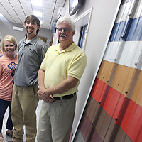 From left, Amy, Casey, Alex and Tim Riley pose in the showroom of Magnum Metals in Nettleton.