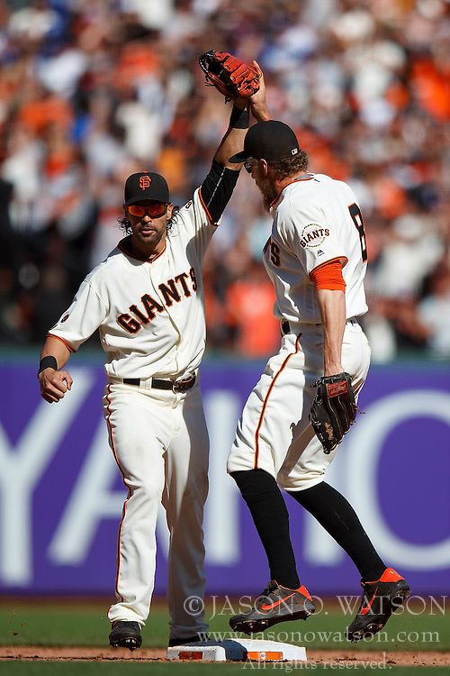 SAN FRANCISCO, CA - OCTOBER 02: Angel Pagan #16 of the San Francisco Giants celebrates with Hunter Pence #8 after the game against the Los Angeles Dodgers at AT&T Park on October 2, 2016 in San Francisco, California. The San Francisco Giants defeated the Los Angeles Dodgers 7-1. (Photo by Jason O. Watson/Getty Images) *** Local Caption *** Angel Pagan; Hunter Pence