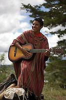 Man playing guitar, Comalapa, Guatemala.