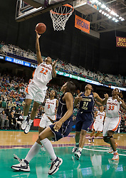 Virginia guard Monica Wright (22) shoots a layup against Georgia Tech.  The #4 seed/#25 ranked Virginia Cavaliers women's basketball team defated the #5 seed Georgia Tech Yellow Jackets 52-43 in the quarterfinals of the 2008 ACC Women's Basketball Tournament at the Greensboro Coliseum in Greensboro, NC on March 7, 2008.