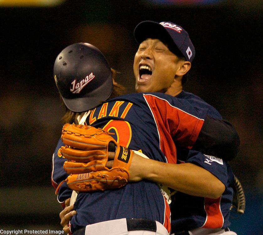 Team Japan's Akinori Otsuka hugs his catcher Tomoya Satozaki after beating Team Cuba 10-6 in Final action of the World Baseball Classic at PETCO Park, San Diego, CA.
