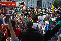 London, UK. 22 June, 2019. Members of the Sudanese community protest outside Downing Street to call for a civilian-led Government in Sudan following the killing earlier this month on the banks of the river Nile by soldiers under the command of the ruling military council of over 100 of the protesters whose actions led to Omar al-Bashir being deposed as President in April after almost 30 years.