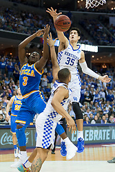 Kentucky forward Derek Willis, right, contests a shot by UCLA guard Aaron Holiday in the second half. <br /> <br /> The University of tKentucky hosted the University of California Los Angeles in a 2017 NCAA Division 1 Sweet 16 game, Friday, March 24, 2017 at FedExForum in Memphis.