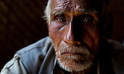 30th April 2015, Sindhupal Chowk District, Nepal. Gaja Raj Bharati (82) in Bharatigaun village, Sindhupal Chowk District, on the 30th April 2015. <br /> He lived through the last major earthquake to hit Nepal 81 years ago in 1934. <br /> <br /> Sindhupalchowk District has seen around 2100 deaths as of 3rd May 2015 which is nearly a third of all fatalities recorded in Nepal from the earthquake with magnitude 7.8 that occurred near Lamjung, Nepal, 50 miles northeast of the capital Kathmandu at 06:11:26 UTC on Apr 25, 2015. The capital has seen considerable devastation including the nine-story Dharahara Tower, one of Kathmandu's landmarks built by Nepal's royal rulers as a watchtower in the 1800s and a UNESCO-recognised historical monument. It was reduced to rubble and there were reports of people trapped. Portions of historic buildings in the World Heritage gazetted site of Patan have also been destroyed as well as many buildings in the old city. <br /> <br /> PHOTOGRAPH BY AND COPYRIGHT OF SIMON DE TREY-WHITE<br /> <br /> + 91 98103 99809<br /> email: simon@simondetreywhite.com<br /> photographer in delhi