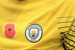 28 October 2017 -  Premier League - West Bromwich Albion v Manchester City - A poppy printed onto the shirt of City goalkeeper Ederson - Photo: Marc Atkins/Offside