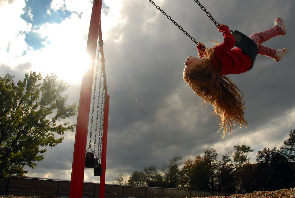 10/27/07 2:46:18 PM -- Springfield, VA, U.S.A  -- Lauren Westcott, 4, of Virginia Beach, Va., rides a swing at Forestdale Elementary School in Springfield, Va., on Saturday, Oct. 27, 2007.  After 3 days of much needed rain, warm temperatures and sunshine returned to the region...Photo by Jay Westcott, Freelance.