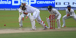August 4, 2017 - Colombo, Sri Lanka - Sri Lankan cricket captain Dinesh Chandimal(L) plays a shot as Indian wicket keeper Wriddhiman Saha (2L) looks on during the 2nd Day's play in the 2nd Test match between Sri Lanka and India at the SSC international cricket stadium at the capital city of Colombo, Sri Lanka on Friday 04 August 2017. (Credit Image: © Tharaka Basnayaka/NurPhoto via ZUMA Press)