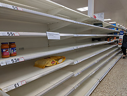 UK: as anxiety over Corona Virus COVID-19 rises, panic buying in supermarkets across the country have stripped certain products from the shelves. In particularl pastas, tinned foods, frozen foods, toilet roll, parecetamol and other pain killers have been bought in bulk.