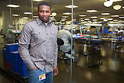 DETROIT, MI - OCTOBER, 30: Movement Assembly Line Leader Willie Holley, 27, of Detroit, MI, at the Shinola corporate offices and factory in Detroit, Michigan, Thursday, October 30, 2014. (Photo by Jeffrey Sauger)