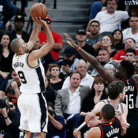 03 May 2017: San Antonio Spurs guard Tony Parker (9) takes a jump shot over Houston Rockets center Clint Capela (15) during the San Antonio Spurs 121-96 victory over the Houston Rockets, in game 2 of the Western Conference Semi Finals, at the AT&T Center, San Antonio, Texas, USA.