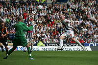 Photo: Lee Earle.<br /> West Bromwich Albion v Hull City. Coca Cola Championship. 05/08/2006. Albion's John Hartson (R) beats Hull keeper Boaz Myhill to open the scoring.
