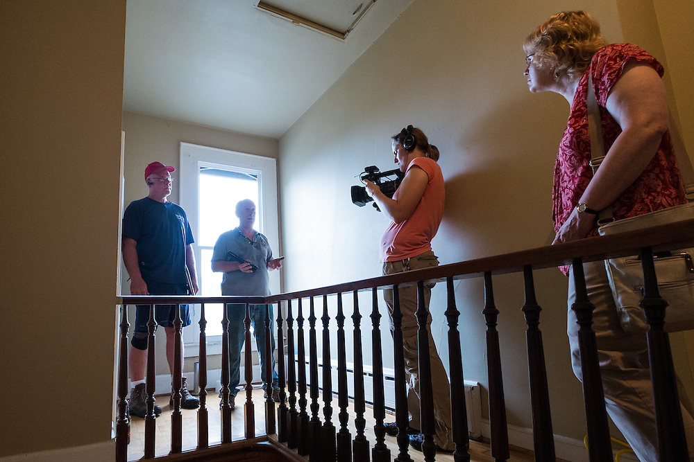 Michael Cumberledge, Jr. (left) and Mike Lehman describe the energy audit process at 47 West Washington Street for the camera on Tuesday, June 23, 2015.  Photo by Ohio University  /  Rob Hardin