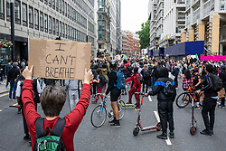 """© Licensed to London News Pictures. 03/06/2020. London, UK. A man holds up a sign saying """"I CAN'T BREATHE"""" during a """"Justice for Black Lives"""" demonstration. Protests have taken place across the United States and in cities around the world in response to the killing of George Floyd by police officers in Minneapolis on 25 May. Photo credit: Rob Pinney/LNP"""