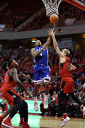 21 February 2018:  De'Antae McMurray lays it up defended by Isaac Gassman during a College mens basketball game between the Drake Bulldogs and Illinois State Redbirds in Redbird Arena, Normal IL