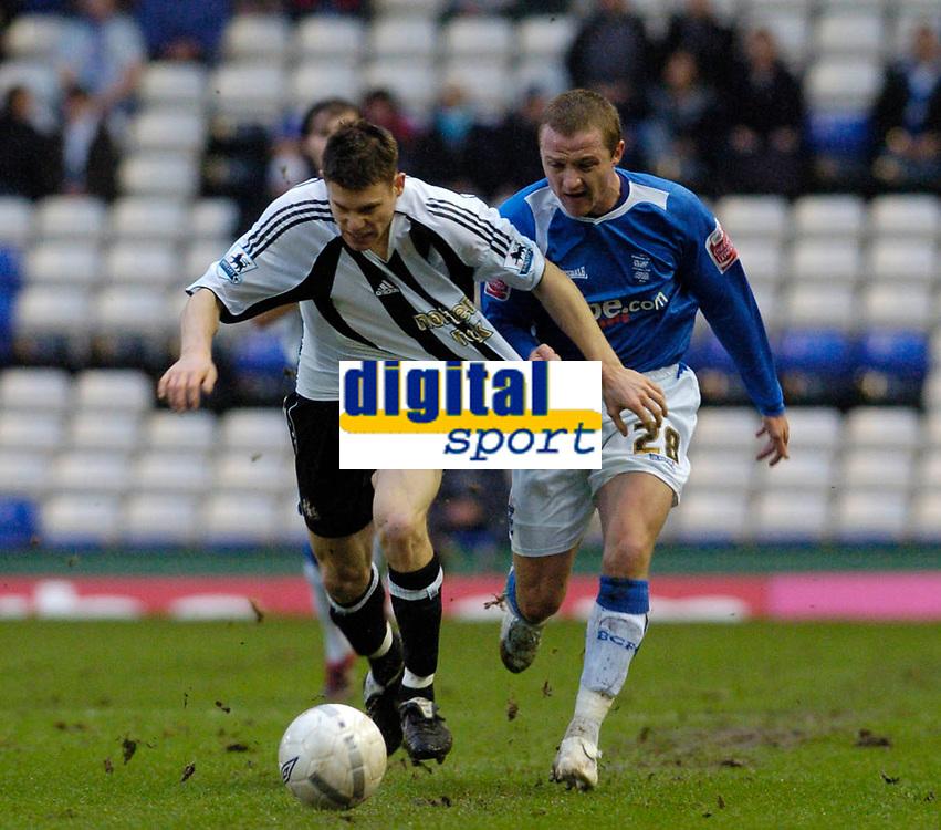 Photo: Leigh Quinnell.<br /> Birmingham City v Newcastle United. The FA Cup. 06/01/2007. Birminghams GaryMcSheffrey pulls the shirt of Newcastles  James Milner.