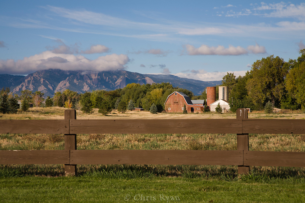 Farm and field with view to the Flatirons and Rocky Mountains, east of Boulder, Colorado