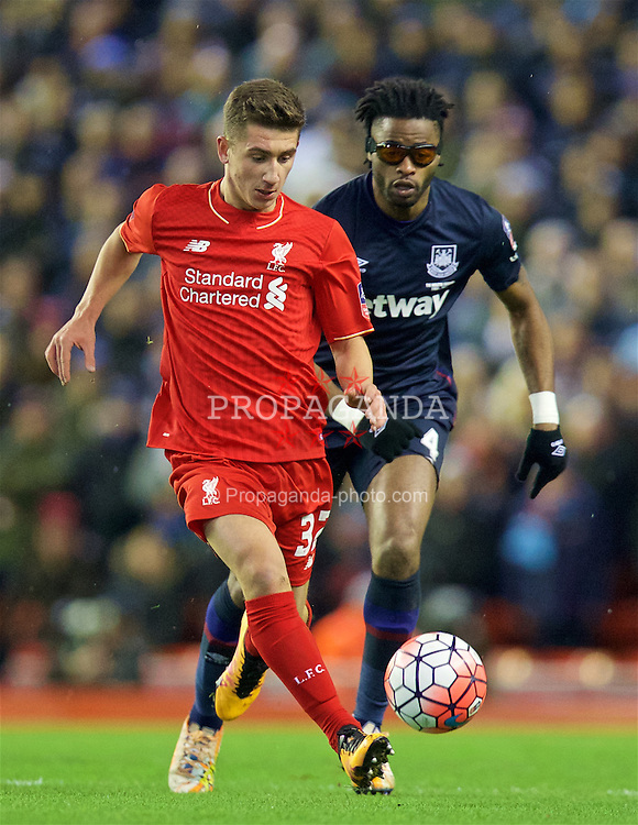 LIVERPOOL, ENGLAND - Saturday, January 30, 2016: West Ham United's Alex Song, wearing protective glasses, in action against Liverpool's Cameron Brannagan during the FA Cup 4th Round match at Anfield. (Pic by David Rawcliffe/Propaganda)