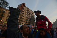 Cairo, Egypt Nov 30, 2012 - Egyptians chant slogans during a demonstration in Tahrir Square in Cairo. Liberal and secular parties held major protests against a recent decree by Egyptian President Mohammed Morsi that grants him near absolute powers beyond judicial review. (Photo by Miguel Juárez Lugo)