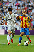 Real Madrid´s Chicharito and Valencia´s Sofiane Feghouli during 2014-15 La Liga match between Real Madrid and Valencia at Santiago Bernabeu stadium in Madrid, Spain. May 09, 2015. (ALTERPHOTOS/Luis Fernandez)