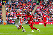 Leyton Orient forward Josh Koroma (19) goes past AFC Flyde defender Jordan Tunnicliffe (5) during the FA Trophy final match between AFC Flyde and Leyton Orient at Wembley Stadium on 19 May 2019.