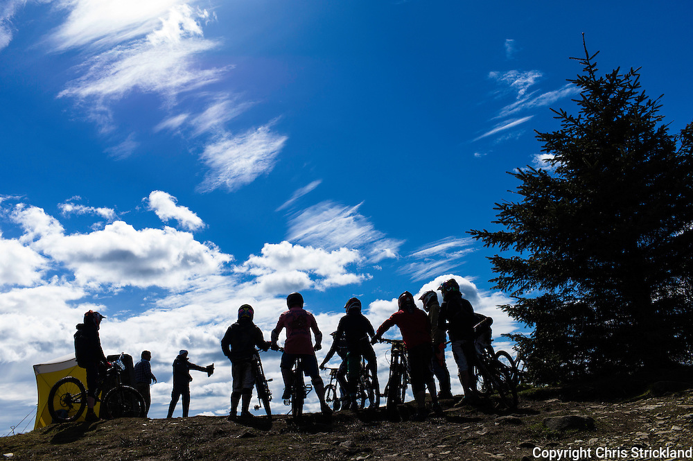 Ae Forest, Dumfries, Scotland, UK. 25th April 2015. Downhill Mountain Bikers at the start gate on the 7Stanes course at Ae during the Scottish Downhill Association racing.