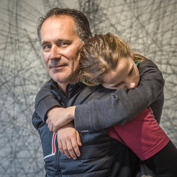 Petaluma photographer Bill Richardson carries his twelve year old daughter, Veronica, at the Indian Springs Art Gallery in Calistoga