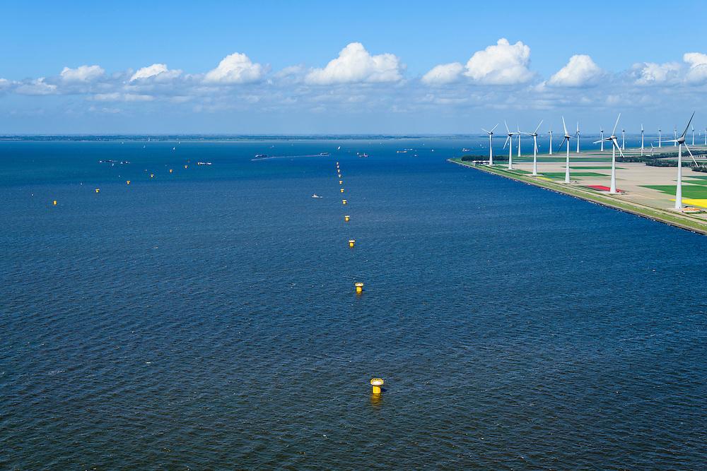 Nederland, Flevoland, Noordoostpolder,  07-05-2015. Westermeerdijk, ten noorden van Urk. Bouw van het grootste windmolenpark van Nederland, Windpark Noordoostpolder. De mega windmolens worden zowel op land als in het IJsselmeer gebouwd, in het water de fundamenten.<br /> Het windmolenpark van de Koepel Windenergie Noordoostpolder is een initiatief van NOP Agrowind, energiebedrijf RWE/Essent en Westermeerwind.<br /> Construction of the largest wind farm in the Netherlands, Wind farm Northeast Polder. On land and offshore.<br /> luchtfoto (toeslag op standard tarieven);<br /> aerial photo (additional fee required);<br /> copyright foto/photo Siebe Swart