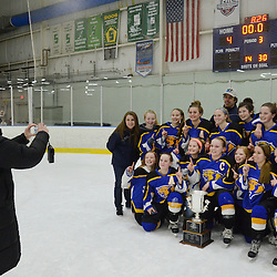 Staff photos by Tom Kelly IV<br /> East players pose with the cup as a family member takes photos on the ice following the Downingtown East vs Unionville girls Flyer's Cup Championship, Wednesday night March 19, 2014 at Ice Line in West Goshen.