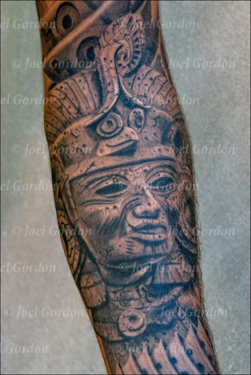 Aztec or Mayan tattoos <br /> <br /> Body art or tattoos has entered the mainstream it is no longer considered a weird kind of subculture.<br /> <br /> &quot;According to a 2006 Pew survey, 40% of Americans between the ages of 26 and 40 have been tattooed&quot;.
