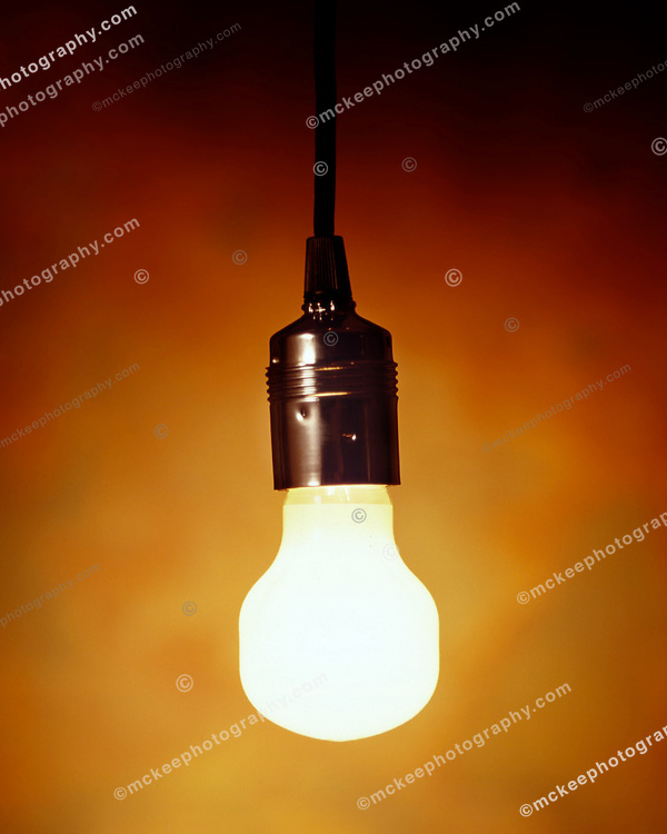 light bulb glowing in a warm fuzzy background