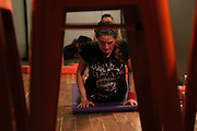 NEW YORK CITY, NEW YORK, MARCH 30, 2016. Caryn Havlik participates in Metal Bones Yoga. The class takes place at 6:30 p.m. on Wednesdays at The Cobra Club in Bushwick, Brooklyn. 03/30/2016. Photo by Donna M. Airoldi/NYC News Service