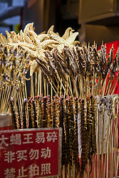 "Night Market, Beijing, China. Starfish on a skewer? Bugs?  Centipedes? Scorpions?  Such ""delicacies"" await brave foodies in some of Beijing's night markets."