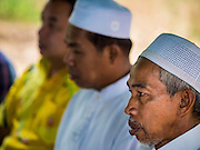 26 DECEMBER 2014 - MAE KHAO, PHUKET, THAILAND: Imams from mosques in Phuket participate in a memorial service at the Tsunami Memorial Wall in Mae Khao, Phuket. The wall is located at the site that was used as the main morgue for people killed in the tsunami and hosts an annual memorial service. Nearly 5400 people died on Thailand's Andaman during the 2004 Indian Ocean Tsunami that was spawned by an undersea earthquake off the Indonesian coast on Dec 26, 2004. In Thailand, many of the dead were tourists from Europe. More than 250,000 people were killed throughout the region, from Thailand to Kenya. There are memorial services across the Thai Andaman coast this weekend.    PHOTO BY JACK KURTZ