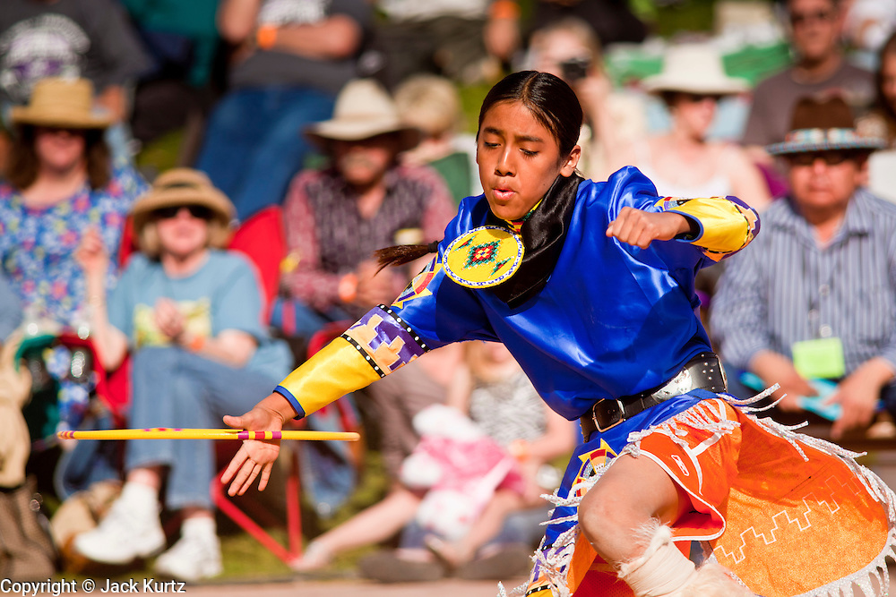 06 FEBRUARY 2011 - PHOENIX, AZ: TALON DUNCAN, an Apache Hidatsa Arikava Indian, from Mesa, AZ, performs at the 21st Annual Heard Museum World Championship Hoop Dance Contest at the Heard Museum in Phoenix, AZ, Sunday, February 6. Hoop dancing has a long tradition among Native American peoples. The hoop or circle is symbolic to most Native people. It represents the Circle of Life and the continuous cycle of summer and winter, day and night, male and female. Some native people use hoop dancing as a part of healing ceremonies designed to restore balance and harmony in the world.      Photo by Jack Kurtz