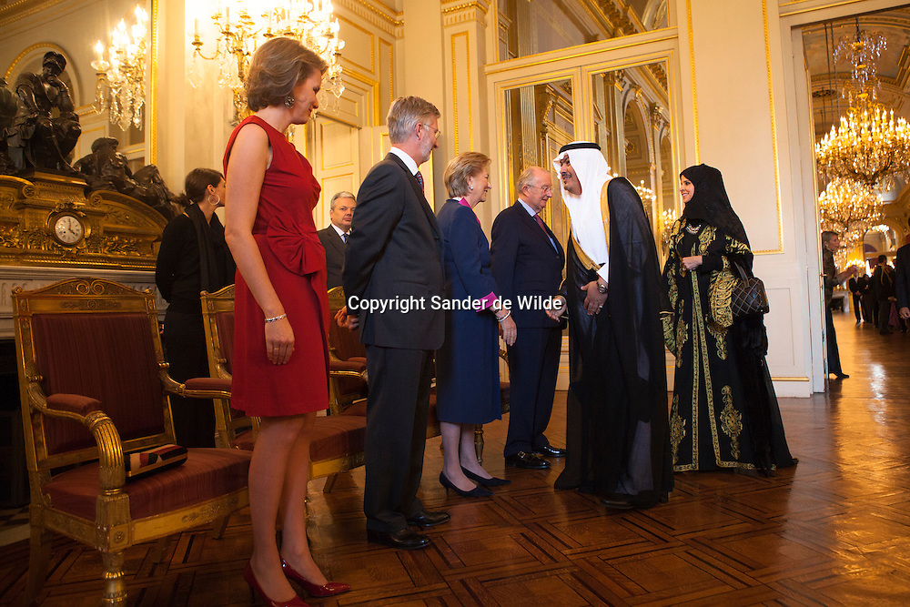 Suleiman Hamed Salem Al Mazroui (2nd R), UAE ambassador to Belgium, and his wife Alia (R) are welcomed by Belgium's Crown Princess Mathilde (L), Crown Prince Philippe (2nd L), Queen Paola and King Albert of Belgium (3rd R) at the start of a traditional New Year reception at the Brussels Royal Palace January 11, 2012.