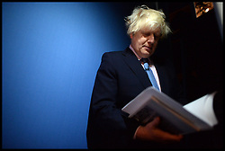 Mayor of London Boris Johnson backstage checking his speech before going on stage at the Conservative Party Annual Conference. Manchester, United Kingdom. Tuesday, 1st October 2013. Picture by Andrew Parsons / i-Images