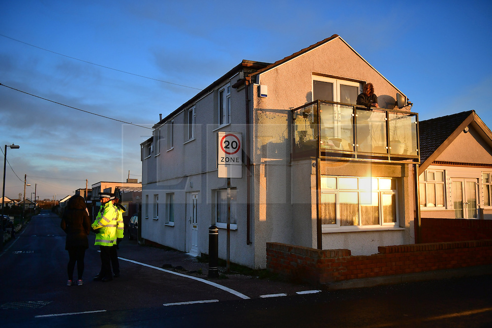 © Licensed to London News Pictures. 13/01/2017. Jaywick, UK. A man looks out over the sea, from the balcony of his property  on the seafront at Jaywick before Homes are evacuated in Jaywick, Essex  due to the threat of flooding in low-lying areas . Photo credit: Ben Cawthra/LNP