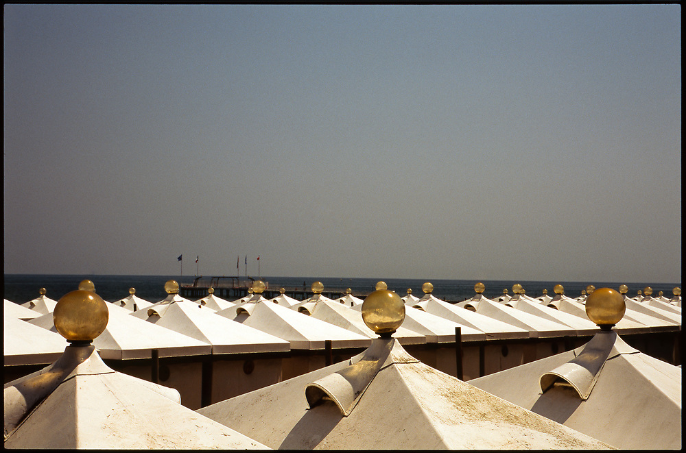 Rows of beach tents, Venice, Italy