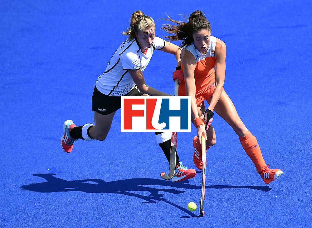 Germany's Franzisca Hauke (L) vies with Netherlands' Naomi van As during the women's semifinal field hockey Netherlands vs Germany match of the Rio 2016 Olympics Games at the Olympic Hockey Centre in Rio de Janeiro on August 17, 2016. / AFP / MANAN VATSYAYANA        (Photo credit should read MANAN VATSYAYANA/AFP/Getty Images)