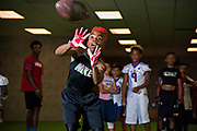 """Maxwell """"Bunchie"""" Young, 10, works on his ball-handling skills during rapid fire drills at Laced Facts, an elite training facility in South L.A. that works on speed, strength, and agility for football players."""