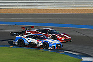 BURIRAM, THAILAND - OCTOBER 08: GT-500 car #24 Nissan Forum Engineering ADVAN GT-R of Daiki Sasaki / Joao Paulo Lima de Oliveira, GT-300 car #50 Ferrari 488 GT of Akihiro Tsuzuki / Morio Nitta on Turn 12 during the 2017 AUTOBACS SUPER GT Round7 Chang SUPER GT RACE , Chang International Circuit, Buriram, Thailand on October 08, 2017.<br /> .<br /> .<br /> .<br /> (Photo by: Naratip Golf Srisupab/SEALs Sports Images)<br /> .<br /> Any image use must include a mandatory credit line adjacent to the content which should read: Naratip Golf Srisupab/SEALs Sports Images