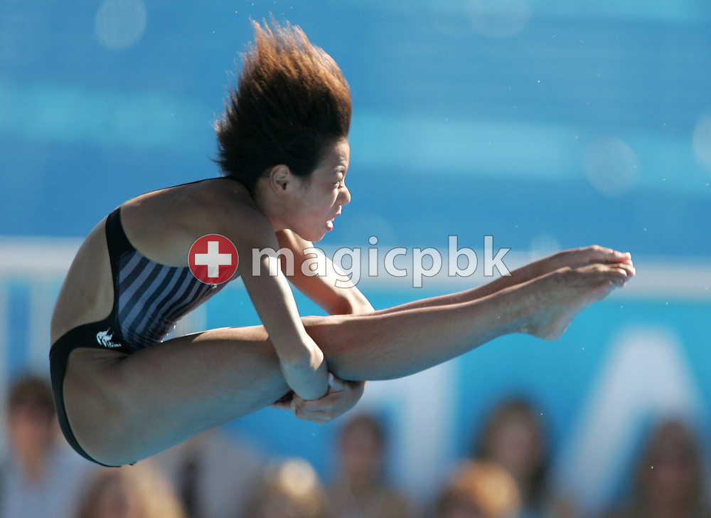 China's Jia Tong dives during the final round of the women's 10m platform competition at the FINA World Championships in Montreal, Quebec Wednesday 20 July, 2005. Laura Ann Wilkinson of the USA took the gold, Loudy Tourky of Australia took the silver and Jia Tong of China took the bronze. (Photo by Patrick B. Kraemer / MAGICPBK)