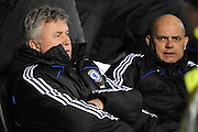 Guus Hiddink (L-Chelsea Manager) and Ray Wilkins (R-Chelsea Assistant First Team Coach )watch from the bench during the Barclays Premier League match between Portsmouth and Chelsea at Fratton Park on March 3, 2009 in Portsmouth, England.