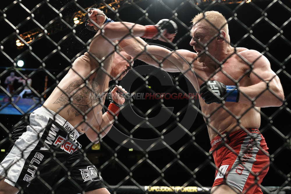 """MANCHESTER, ENGLAND, NOVEMBER 14, 2009: Paul Kelly (left) and Dennis Siver during """"UFC 105: Couture vs. Vera"""" inside the MEN Arena in Manchester, United Kingdom."""