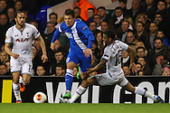 Aleksandr Kobakhidze of Dnipro Dnipropetrovsk (centre) evades the challenge from Kyle Naughton of Tottenham Hotspur (right) during the UEFA Europa League match at White Hart Lane, London<br /> Picture by David Horn/Focus Images Ltd +44 7545 970036<br /> 27/02/2014