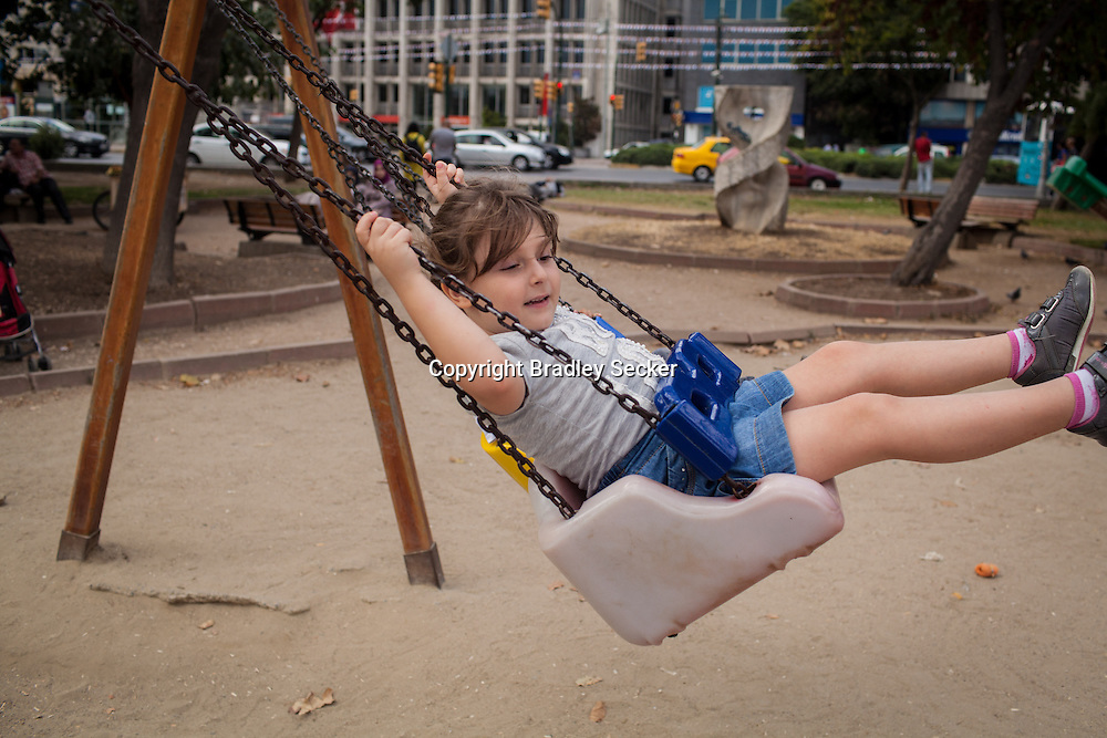 Zia, 6 from Homs, Syria, plays in a park in Istanbul, Turkey.