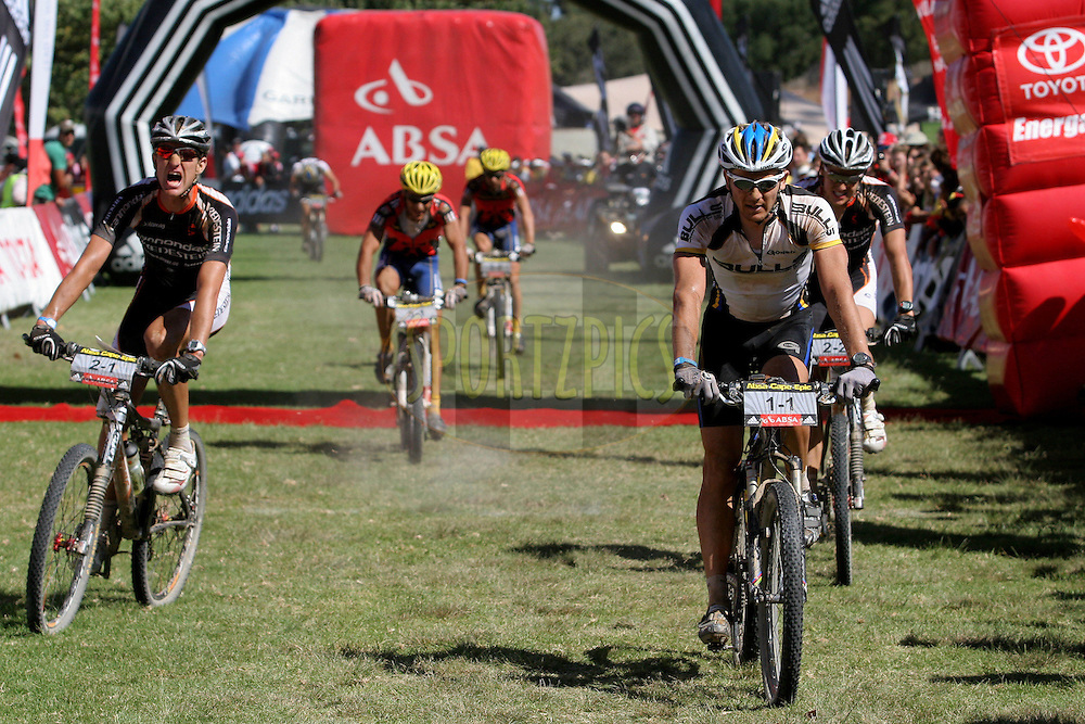 WESTERN CAPE, SOUTH AFRICA -  31 March 2008, The painful sprint finish at the end of stage three of the 2008 Absa Cape Epic Mountain Bike stage race from Calitzdorp Spa.to Langenhoven High School in Riversdale, Western Cape, South Africa..Photo by Patrick Cruywagen/SPORTZPICS