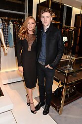 CLARA PAGET and GEORGE BARNETT at a party hosted by Gucci & Clara Paget to drink a new cocktail 'I Bamboo You' held at Gucci, 34 Old Bond Street, London on 16th October 2013.