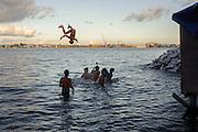 Boys play in the ocean near Yolonda Village.
